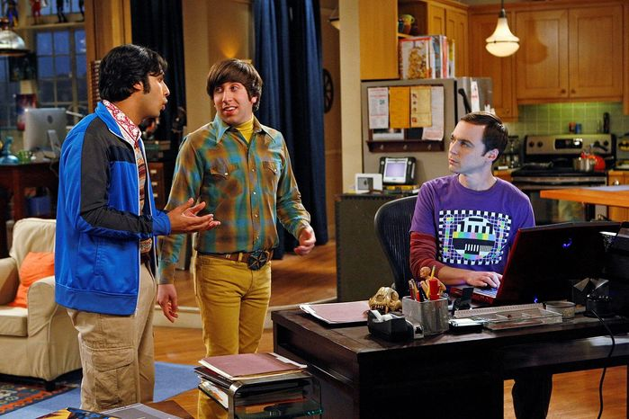 """From left, Kunal Nayyar, Simon Helberg and Jim Parsons star in """"The Big Bang Theory"""" on CBS. The 100th episode airs on Jan. 19. (Associated Press)"""