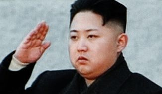 Kim Jong-un, the youngest son and designated successor to the late Kim Jong-il as North Korean dictator, salutes during the funeral for his father in Pyongyang, North Korea, on Wednesday, Dec. 28, 2011. (AP Photo)