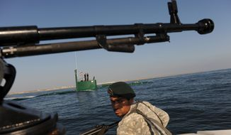 ** FILE ** The Iranian navy patrols in the Sea of Oman, which is near the strategic oil shipping routes in the Strait of Hormuz, on Wednesday, Dec. 28, 2011. (AP Photo)