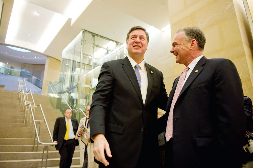 Tim Kaine (right) and George Allen, candidates for U.S. Senate in Virginia, greet each other in the hallway before beginning their first debate for the 2012 campaign at the annual AP Day at the Virginia State Capitol in December. The men, both former Virginia governors, are currently in a dead heat. (Andrew Harnik/The Washington Times)