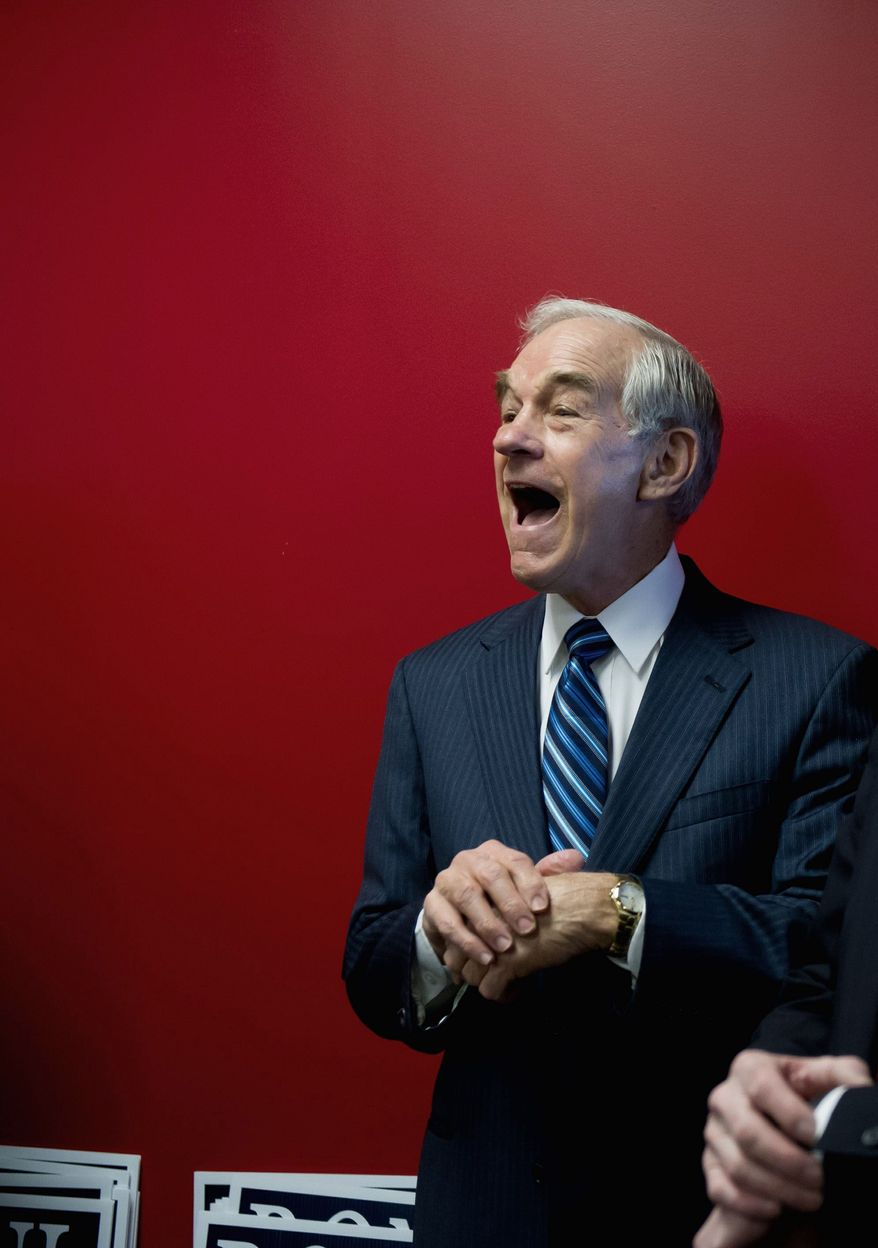 HAPPY CAMPER: GOP presidential candidate Ron Paul gets a kick out of hearing compliments for being punctual at a town hall Wednesday in Newton, Iowa. (Andrew Harnik/The Washington Times)