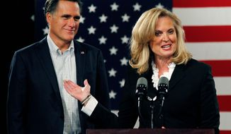 Mitt Romney, shown with his wife, Ann, says he would back any Republican nominee challenging President Obama - including Texas Rep. Ron Paul. Fellow Republican challenger Newt Gingrich said he felt he could not support Mr. Paul. Mrs. Romney confirmed reports that she was the one who had to talk her husband into running for president again. (Associated Press)