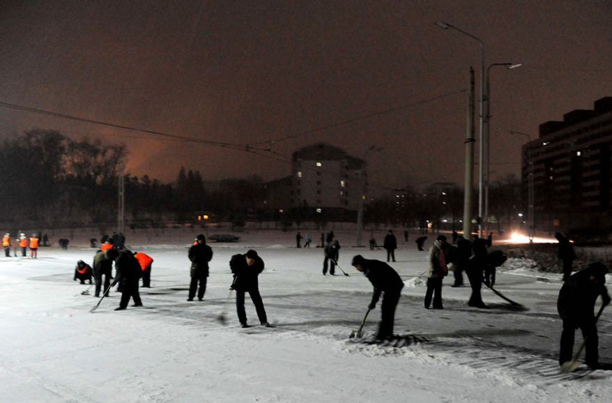 Pyongyang residents sweep snow from the streets before the funeral procession for late North Korean leader Kim Jong Il, in Pyongyang, North Korea Wednesday Dec. 28, 2011.  (AP Photo)
