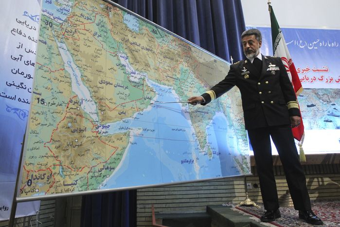 Adm. Habibollah Sayyari, Iran's naval chief, briefs the media in Tehran on Thursday, Dec. 22, 2011, about a 10-day naval exercise in international waters beyond the strategic Strait of Hormuz. (AP Photo/Fars News Agency, Hamed Jafarnejad)