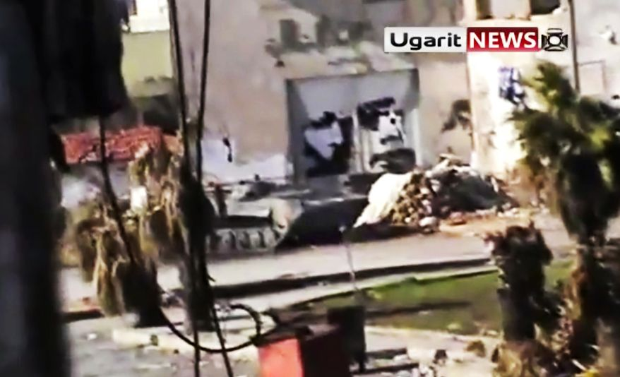This image made from amateur video and released by Ugarit News Group on Tuesday, Dec. 27, 2011, purports to show a Syrian military tank in Homs, Syria. (AP Photo/Ugarit News Group via APTN)