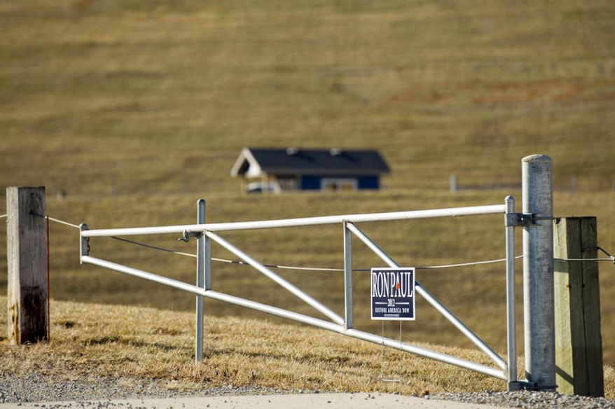 A sign supporting Republican presidential candidate Ron Paul sits near the Iowa Speedway. (Andrew Harnik / The Washington Times)