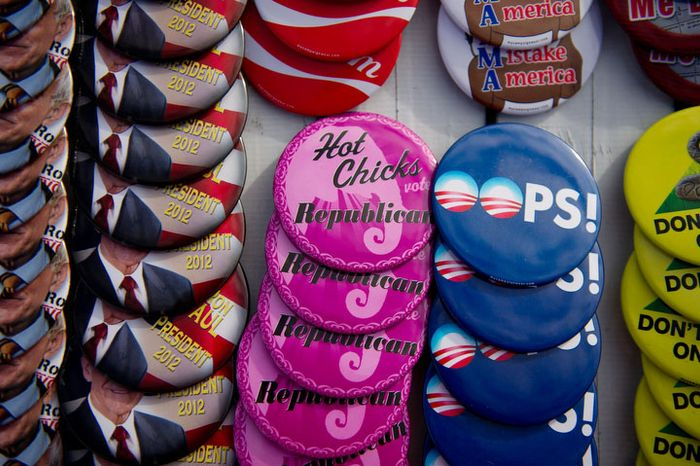 Buttons are for sale outside a Jasper County town hall meeting held at the inner track of the Iowa Speedway where Republican presidential candidate Ron Paul is set to speak to supporters, Newton, IA, Wednesday, December 28, 2011. (Andrew Harnik / The Washington Times)