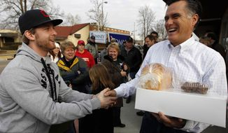Republican presidential candidate, former Massachusetts Gov. Mitt Romney greets supporters after a campaign stop at Homer's Deli and Bakery in Clinton, Iowa, Wednesday, Dec. 28, 2011. (AP Photo/Chris Carlson)