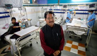 In this Tuesday, Nov. 22, 2011 photo, dalit Hari Kishan Pippal, 60, a member of India's outcast community once known as untouchables, poses for a photograph inside his Heritage Hospital, one of the largest private medical facilities in the north Indian city of Agra. Raised in poverty, he only made it through high school before his father became ill, and he had to go to work pulling a rickshaw to support the family. The vast majority of India's 170 million dalits live amid a thicket of grim statistics: less than a third are literate, well over 40 percent survive on less than $2 a day, infant mortality rates are dramatically higher than among higher castes. Pippal now owns a hospital, a shoe factory, a car dealership and a publishing company. (AP Photo/Saurabh Das)
