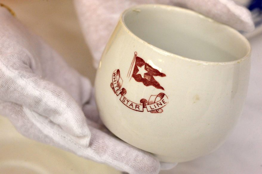 A piece of china used by third-class passengers of the Titanic is part of a collection that will be up for auction. (Associated Press)