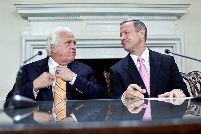 "Maryland Gov. Martin O'Malley, here with state Senate President Thomas V. Mike Miller Jr., supports raising the ""flush tax"" and making it more progressive. (T.J. Kirkpatrick/The Washington Times)"