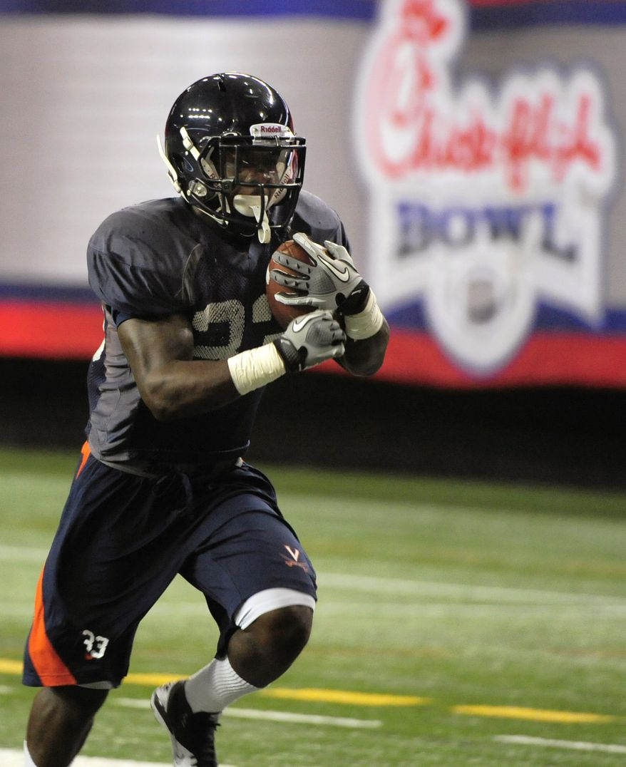 Virginia tailback Perry Jones runs during practice for the Chick-fil-A Bowl at the Georgia Dome on Tuesday, Dec. 27, 2011, in Atlanta. (AP Photo/David Tulis)