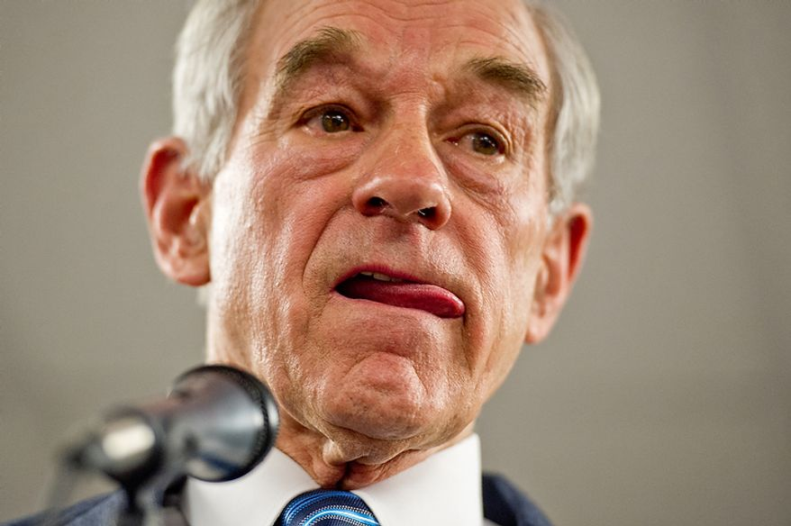 Republican presidential candidate Ron Paul takes questions from members of the audience after delivering a speech to supporters at a Jasper County town hall meeting held at the inner track of the Iowa Speedway, Newton, IA, Wednesday, December 28, 2011. (Andrew Harnik / The Washington Times)