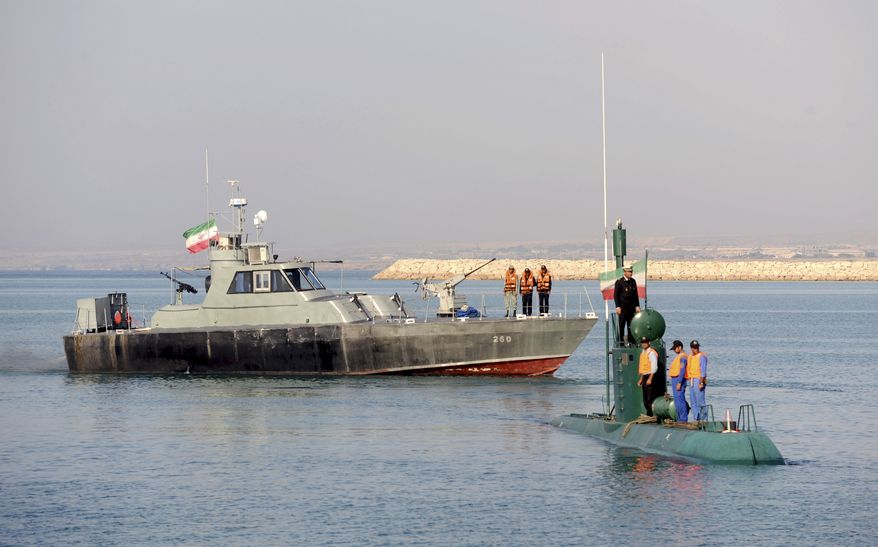 Iranian Navy personnel take part Dec. 28, 2011, in their naval maneuvers dubbed Velayat 90 on the Sea of Oman, Iran. (Associated Press/Xinhua)