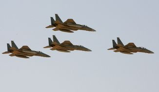 **FILE** F-15 warplanes of the Saudi Air Force fly over Riyadh, Saudi Arabia, on Jan. 25, 2009, during a graduation ceremony at King Faisal Air Force University. (Associated Press)