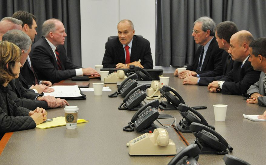 **FILE** New York Police Commissioner Raymond Kelly (center) briefs New York police officials and John O. Brennan (center left), assistant to the president for Homeland Security and Counter-terrorism, and Deputy New York Police Commissioner of Intelligence David Cohen (center right) on Sept. 26, 2009, at police headquarters in New York on events surrounding an alleged plot to bomb New York commuter trains. (Associated Press/NYPD)