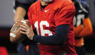 Virginia quarterback Michael Rocco prepares to pass during practice for the Chick-fil-A Bowl at Georgia Dome on Tuesday, Dec. 27, 2011, in Atlanta. Saturday's game against Auburn will be the first time any Virginia players on the current team have appeared in a bowl game. (AP Photo/David Tulis)