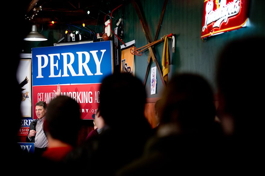 Republican presidential candidate Rick Perry speaks to a full room at the Fainting Goat Restaurant, Waverly, IA, Friday, December 30, 2011. (Andrew Harnik / The Washington Times)