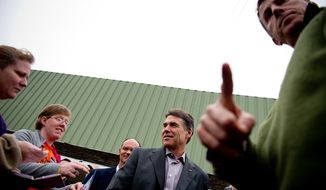 Republican presidential candidate Rick Perry speaks with supporters in the parking lot outside the Fainting Goat Restaurant where he spoke to a full room, Waverly, IA, Friday, December 30, 2011. (Andrew Harnik / The Washington Times)