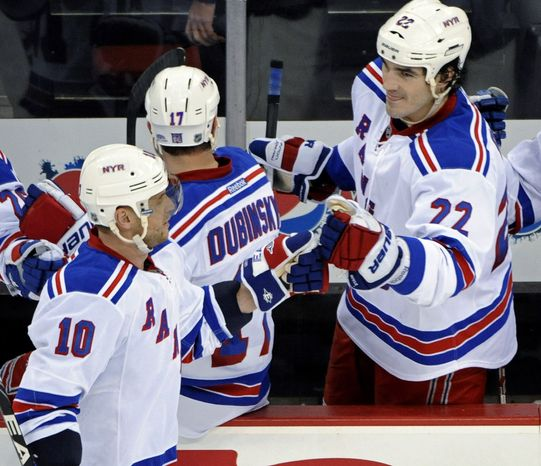 New York Rangers' Brian Boyle (right) has two goals and eight points this season in a third-line center role. His 6-foot-7 frame also makes him a valuable penalty killer. (AP Photo/Bill Kostroun)