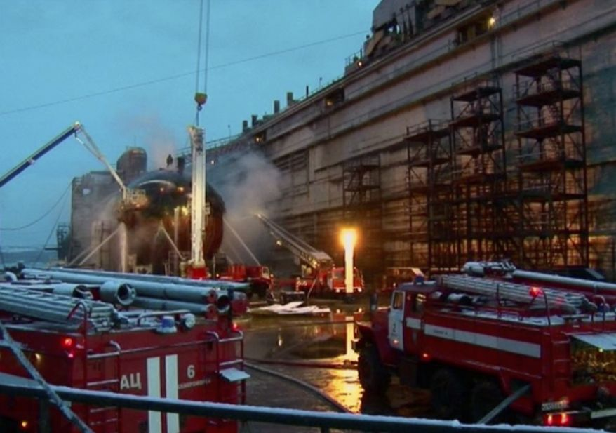 Firefighters spray water on the Yekaterinburg nuclear submarine in a dock at the Roslyakovo shipyard in the Murmansk region, Russia, on Dec. 30, 2011. A fire that erupted while the Yekaterinburg was in drydock left seven crewmembers injured. (Associated Press/Ru-RTR Russian state channel/Via APTN)