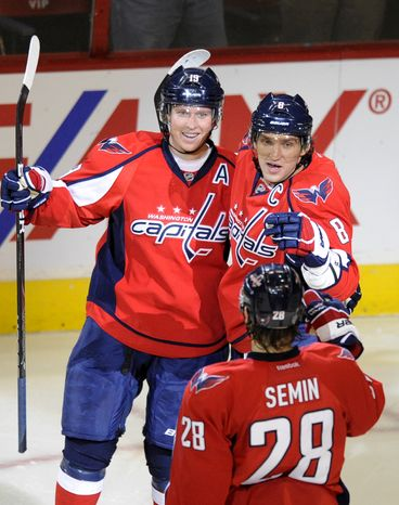Washington Capitals center Nicklas Backstrom celebrates his goal with teammates Alex Ovechkin and Alexander Semin during the second period against the Buffalo Sabres, Friday, Dec. 30, 2011, in Washington. The Caps won 3-1. (AP Photo/Nick Wass)