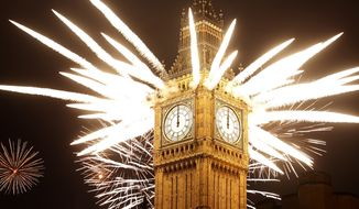 Fireworks explode over the Palace of Westminster, which houses the British Parliament, as London celebrates the arrival of New Year's Day on Sunday, Jan. 1, 2012. (AP Photo/Alastair Grant)
