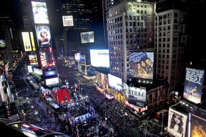 The crowd packs New York's Times Square during the New Year's Eve celebration as seen from the Marriott Marquis hotel, Saturday, Dec. 31, 2011, in New York. (AP Photo/Mary Altaffer)