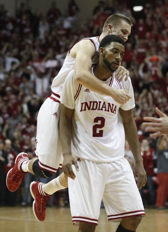 Indiana's Jordan Hulls, left, reacts with teammate Christian Watford during the second half against Ohio State, Saturday, Dec. 31, 2011, in Bloomington, Ind. Indiana won 74-70. Hulls had 17 points, while Watford had 10. (AP Photo/Darron Cummings)