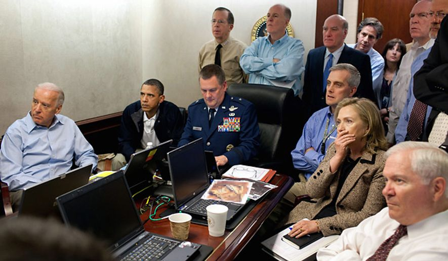 In this image released by the White House, Secretary of State Hillary Rodham Clinton, President Barack Obama and Vice President Joe Biden, along with with members of the national security team, receive an update on the mission against Osama bin Laden in the Situation Room of the White House, Sunday, May 1, 2011. (AP Photo/The White House, Pete Souza)