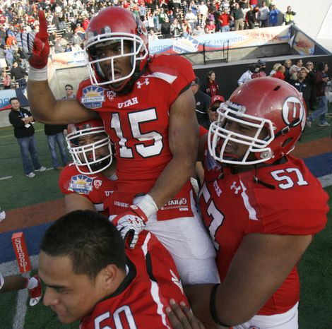 Utah's John White celebrates his game-winning touchdown in overtime against Georgia Tech in the Sun Bowl on Saturday, Dec. 31, 2011, in El Paso, Texas. Utah won 30-27. (AP Photo/The Salt Lake Tribune, Trent Nelson)