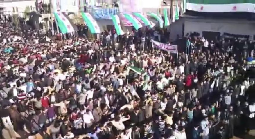 In this image from amateur video made available by the Ugarit News group and shot on Friday, Dec. 30, 2011, protesters gather at an anti-Bashar Assad rally in Hama, Syria. The Associated Press cannot independently verify the content, date, location or authenticity of this material. (AP Photo/Ugarit News Group via APTN)