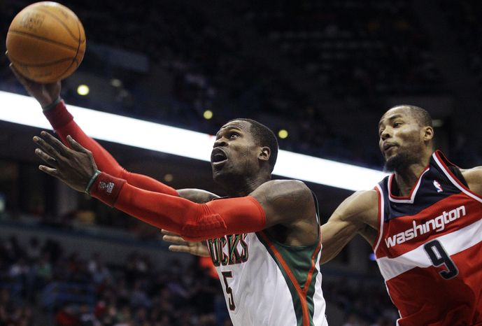 Milwaukee Bucks' Stephen Jackson (5) drives past Washington Wizards' Rashard Lewis (9) during the second half, Friday, Dec. 30, 2011, in Milwaukee. The Bucks won 102-81, and Jackson had seven points. (AP Photo/Morry Gash)