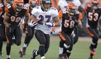 ASSOCIATED PRESS Baltimore running back Ray Rice breaks away from the pack for a 70-yard touchdown against Cincinnati. Rice also had a 51-yard TD run.