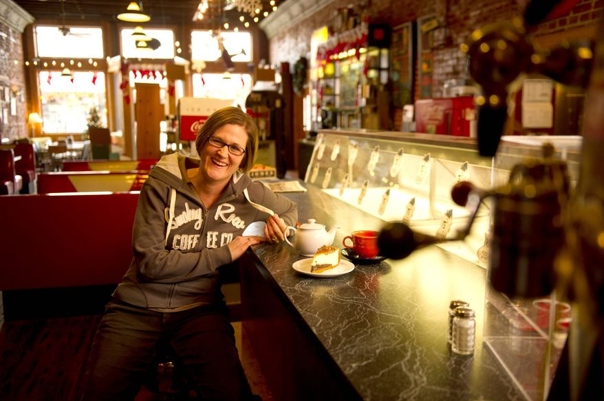 Heather Goode served then candidate Barack Obama a slice of pie and a cup of tea when he stopped at the Smokey Row Coffee House while campaigning in late 2007. Iowans have rubbed elbows with many candidates over the years. (Andrew Harnik/The Washington Times)