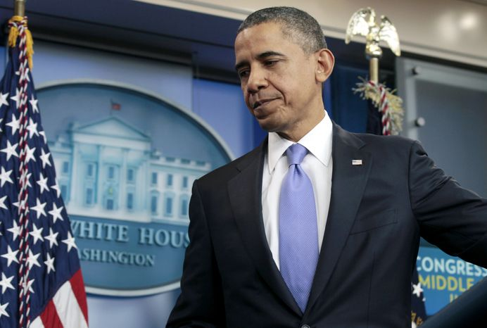 **FILE** President Obama leaves a news conference at the White House on Dec. 8, 2011. (Associated Press)