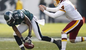 Philadelphia Eagles cornerback Dominique Rodgers-Cromartie (23) recovers a blocked field goal as Washington Redskins kicker Graham Gano (4) pursues during the first half, Sunday, Jan. 1, 2012, in Philadelphia. (AP Photo/Mel Evans)