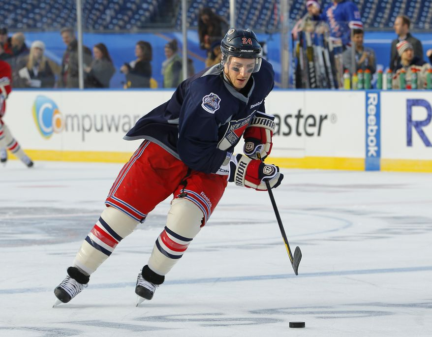New York Rangers captain Ryan Callahan has 13 goals and 28 points this season. The Rangers are slated to play the Philadelphia Flyers in the Winter Classic on Monday, Jan. 2, 2012. (AP Photo/Tom Mihalek)
