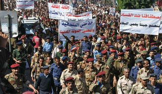 Yemeni soldiers and officers march during a rally demanding reforms and dismissal of a senior official over alleged corruption in Taiz, Yemen, Saturday, Dec. 31, 2011. (AP Photo/Anees Mahyoub)