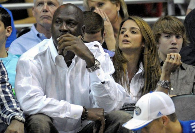 Michael Jordan and Yvette Prieto watch a Charlotte Bobcats game in April 2010. The Bobcats owner and former NBA star became engaged to Ms. Prieto, a Cuban-American model he has dated three years, over Christmas weekend.
