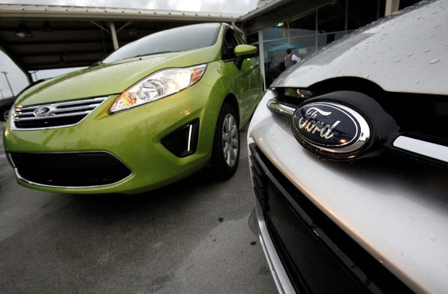 A Lime Squeeze Metallic 2012 Ford Fiesta SE (above left) and an Ingot Silver Metallic 2012 Ford Focus Titanium 5-Door Hatchback are among Ford's current lineup of vehicles. (Associated Press)