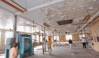 A photograph from June 2007 shows the condition of Weston Hospital before Joe Jordan, and asbestos-removal and demolition contractor, bought it at auction. His family has turned it into a museum hosting year-round paranormal tours and ghost hunts. His daughter Rebecca Jordan shows off an exhibit in the museum. (Associated Press)