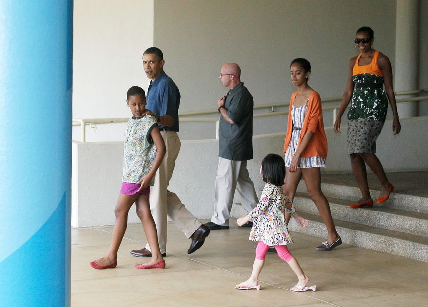 President Obama takes his family to an exhibit about his mother's anthropological work in Honolulu on Sunday before heading for the campaign trail. (Associated Press)