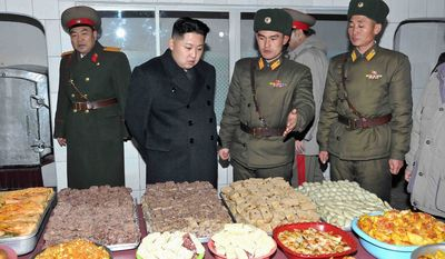 """""""People will be analyzing public appearances, rosters, who was standing next to whom, who was suddenly absent, who suddenly disappears,"""" says Andrei Lankov, a North Korea specialist at Seoul's Kookmin University of the world's interest in the North's new leader, Kim Jong-un, seen inspecting the New Year's Day spread at a military post. (Korean Central News Agency via Associated Press)"""