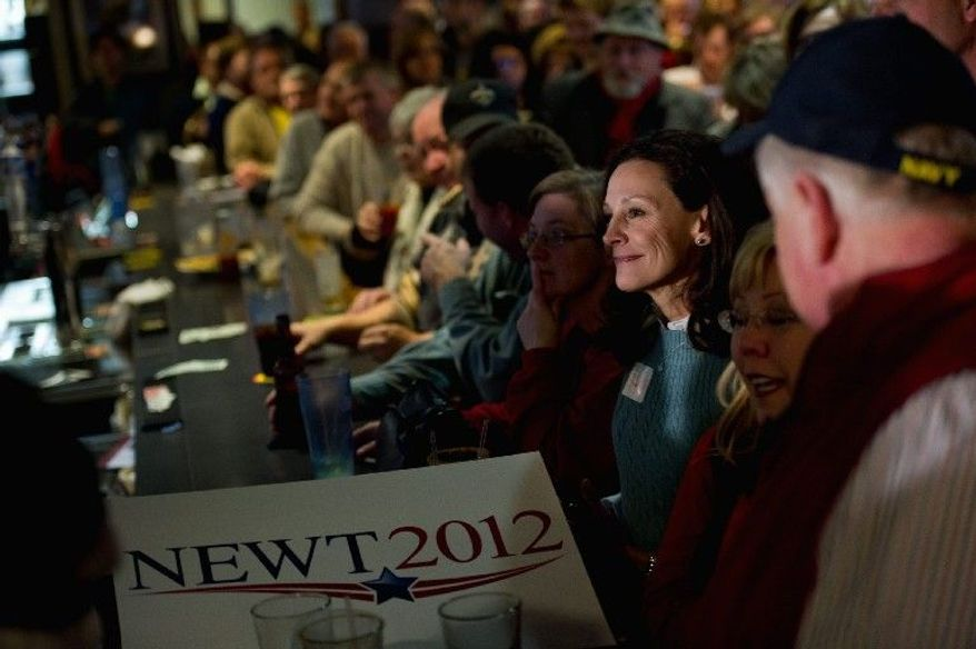 Sheri Meredith (third from right) of Des Moines, Iowa, listens to Republican presidential hopeful Newt Gingrich speak at a campaign stop Sunday at the Junction Sports Bar & Grill in Marshalltown. (Andrew Harnik/The Washington Times)