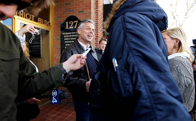Former Utah Gov. Jon Huntsman Jr. greets people during his tour of businesses in downtown Nashua, N.H., on Monday. The Republican presidential candidate has held more than 140 events in the state, which holds its primary Jan. 10. (Associated Press)