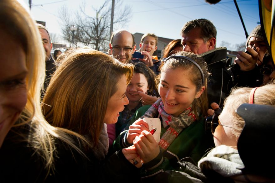Republican presidential candidate Michele Bachmann along side her husband, Marcus, right, greets Juniors and seniors from Taylor High School in Cincinnati, Ohio. (Andrew Harnik / The Washington Times)