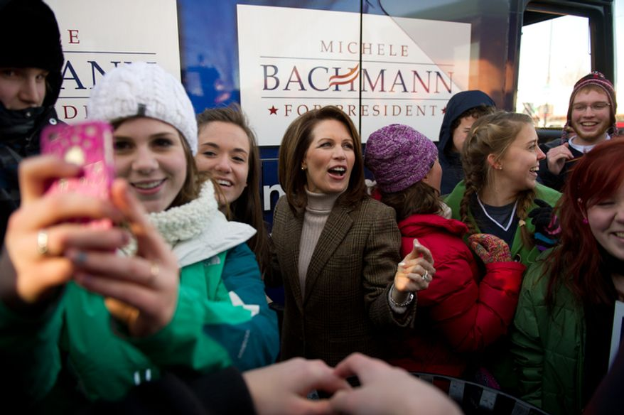 Republican presidential candidate Michele Bachmann dances along side juniors and seniors from Taylor High School in Cincinnati, Ohio. (Andrew Harnik / The Washington Times)