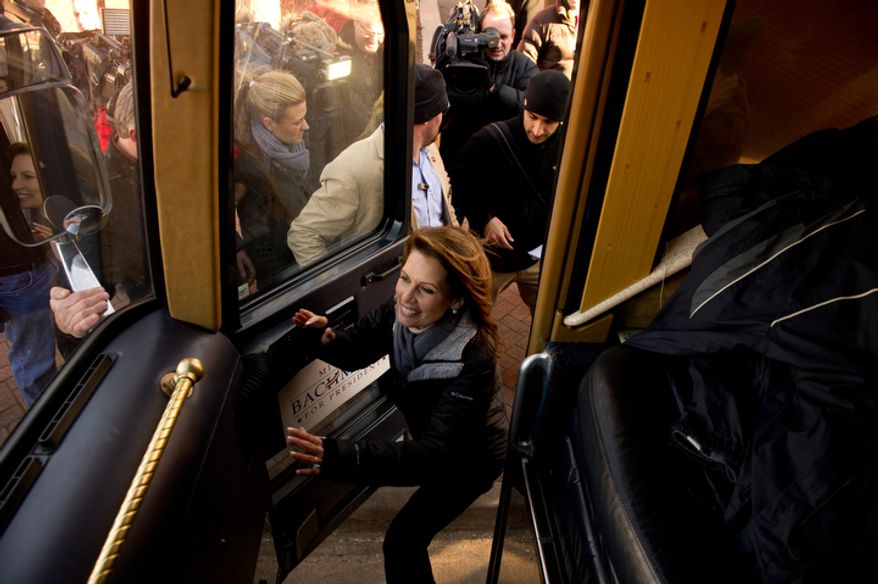 Republican presidential candidate Michele Bachmann gets on her campaign bus. (Andrew Harnik / The Washington Times)
