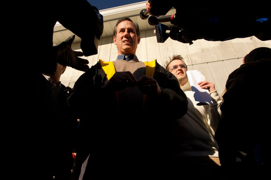Republican presidential candidate Rick Santorum answer a few questions from the media after delivering a speech at a campaign stop at The Reising Sun Cafe. (Andrew Harnik / The Washington Times)